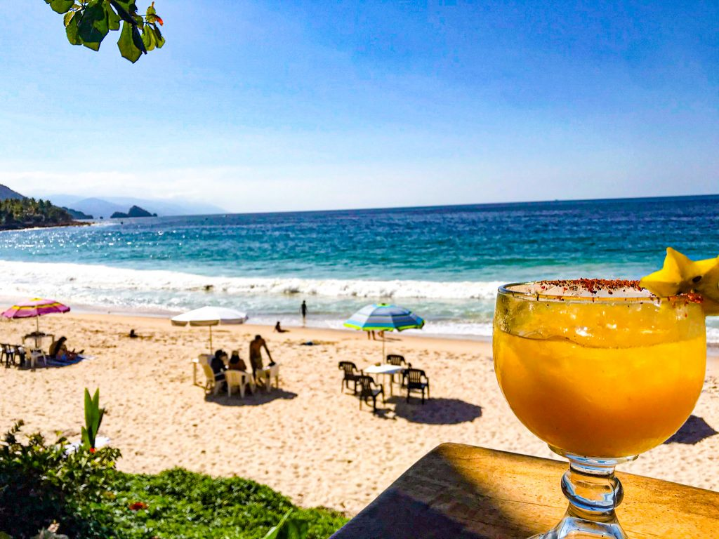 passion fruit margarita on the beach